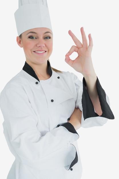 Glücklicher weiblicher chef, der okayzeichen gestikuliert Premium Fotos