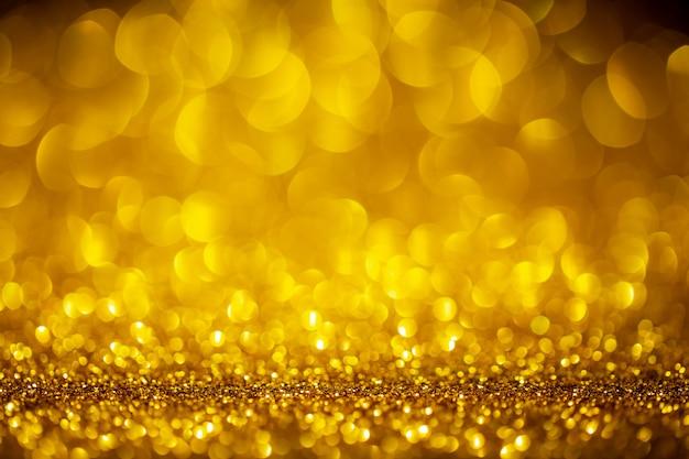 Gold abstrakter raum mit bokeh defokussierten lichtern Premium Fotos