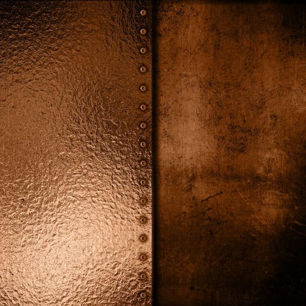 Gold metallplatte auf grunge-hintergrund Kostenlose Fotos