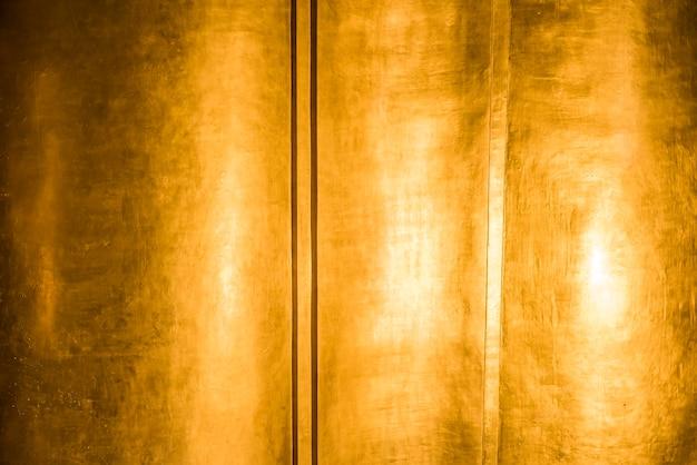 Gold strukturierter hintergrund Kostenlose Fotos