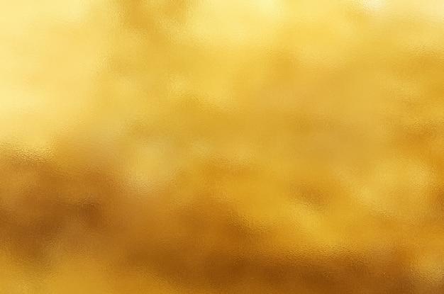 Gold zerknitterter folienbeschaffenheitshintergrund Premium Fotos