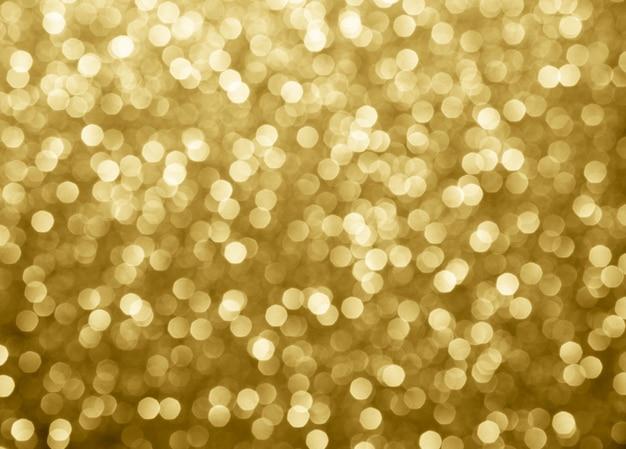 Goldabstrakte hintergrund bokeh kreise für weihnachten Premium Fotos