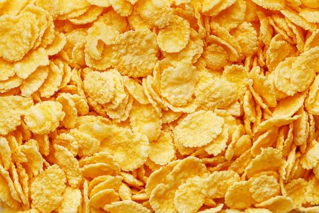 Goldene cornflakes, draufsicht, gesundes frühstück Premium Fotos