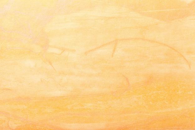 Goldene farbe des hintergrundes der abstrakten kunst. mehrfarbenmalerei auf segeltuch. Premium Fotos