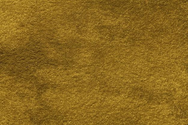 Goldene farbe des hintergrunds der abstrakten kunst. aquarellmalerei auf leinwand mit farbverlauf. textur des alten gelben papiers. Premium Fotos