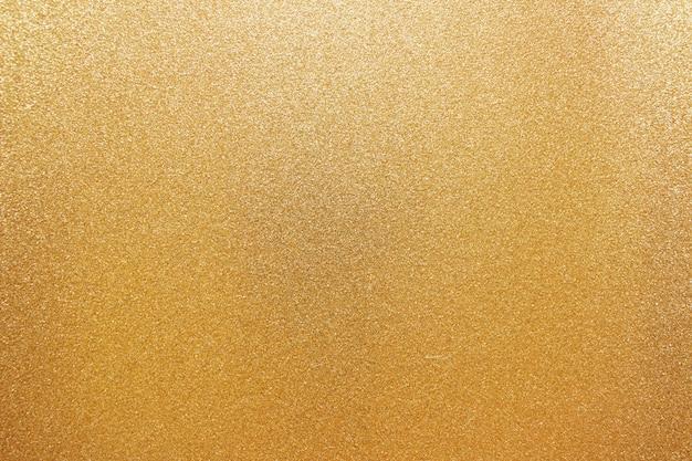 Goldene funkelnde backgound festliche körner Premium Fotos