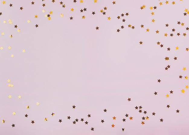 Goldene sterne der netten paillette mit kopienraum Kostenlose Fotos