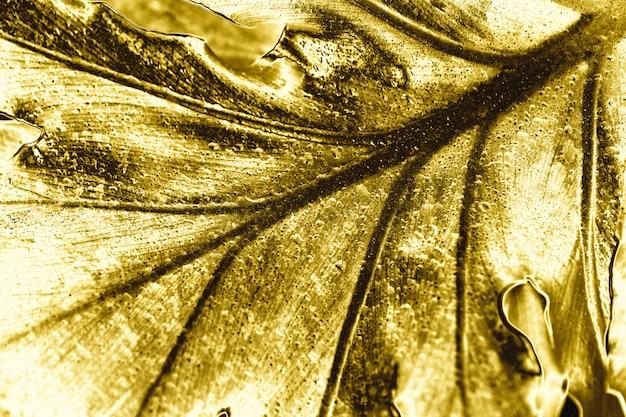 Goldener blatthintergrund Kostenlose Fotos
