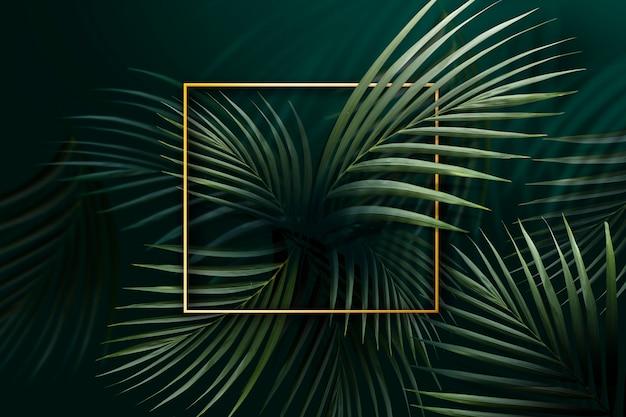 Goldener rahmen auf blättern Premium Fotos