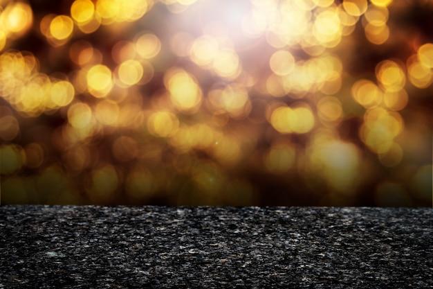 Goldenes bokeh beleuchtet produkthintergrund Kostenlose Fotos