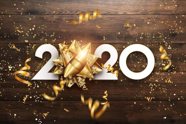 Goldenes zeichen des neuen jahres 2020 auf einem hölzernen hintergrund. Premium Fotos