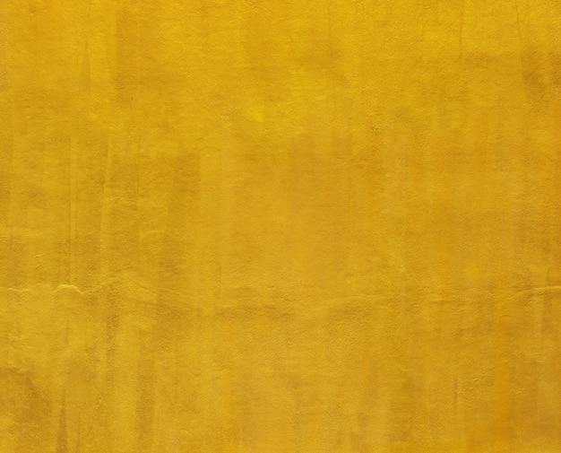Goldfarbenzement-wandhintergrund für design. Premium Fotos