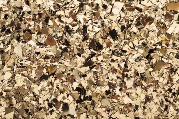 Goldfolie konfetti textur glitzer hintergrund. Premium Fotos