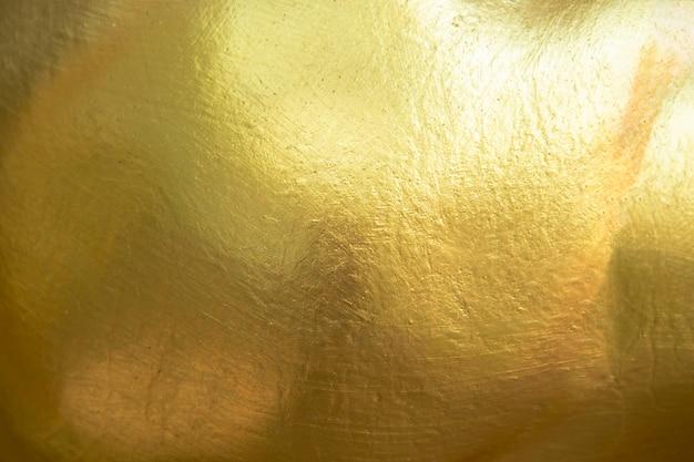 Goldhintergrund oder -beschaffenheit Premium Fotos