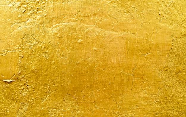 Goldhintergrund oder beschaffenheiten und schatten Premium Fotos