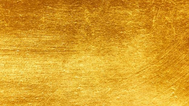Goldmetall gebürsteter hintergrund Premium Fotos