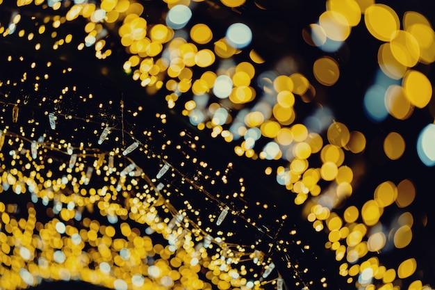 Goldneues jahr beleuchtet abstrakten bokeh-hintergrund Premium Fotos