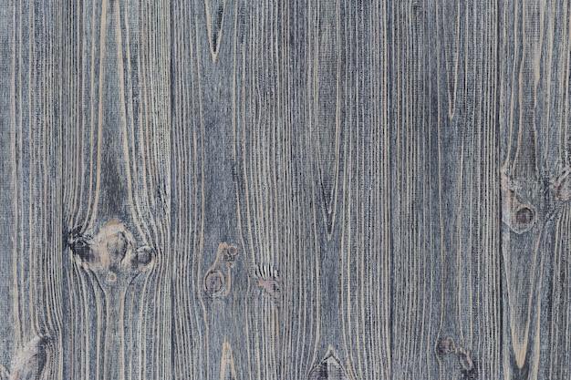 Graue hölzerne schäbige tischbeschaffenheit. kiefernbretter hintergrund. Premium Fotos