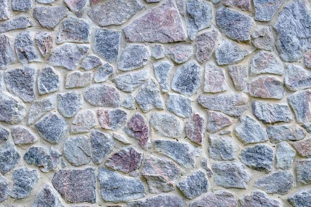 Graue und blaue steinwandbeschaffenheit, alter bodenhintergrund. natürlicher felsboden, muster. ziegeloberfläche Premium Fotos