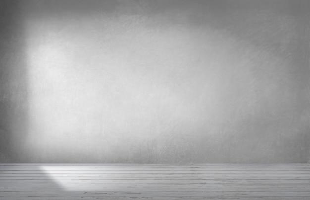 Graue wand in einem leeren raum mit konkretem boden Kostenlose Fotos