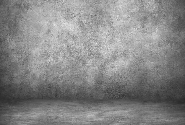 Graue zementwand und studioraum mit hintergrund. leere produktanzeige. Premium Fotos