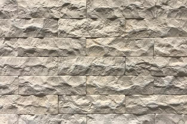 Grauer backsteinmauerbeschaffenheitshintergrund. mit viel platz gekachelt Premium Fotos