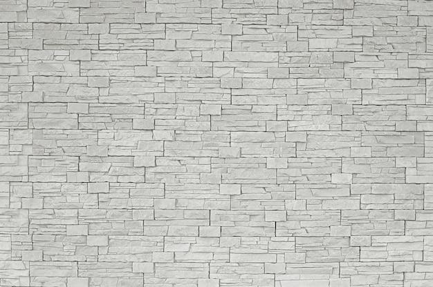 Grauer steinmosaikwandhintergrund Premium Fotos