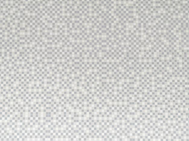Grauer und weißer keramischer abstrakter hintergrund der wandfliesen Premium Fotos