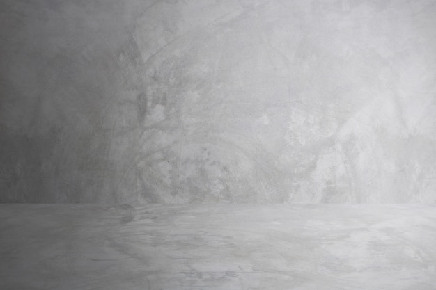Grauer zementwandstudio und leerer bodenhintergrund für anwesendes produkt Premium Fotos