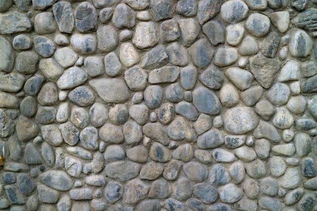 Gray round stone wall texture background Premium Fotos