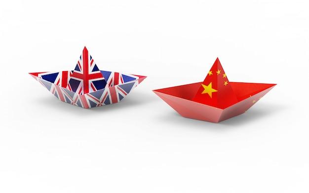Großbritannien- und china-flaggen auf papierboot. Premium Fotos