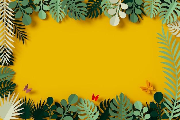 Grüne blätter sind auf gelbem hintergrund, butterfly papierfliege gerahmt Premium Fotos