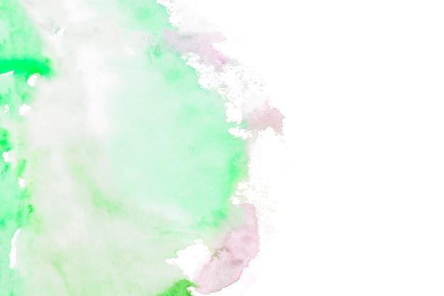 Grüne farbenanschläge auf weißem hintergrund Kostenlose Fotos
