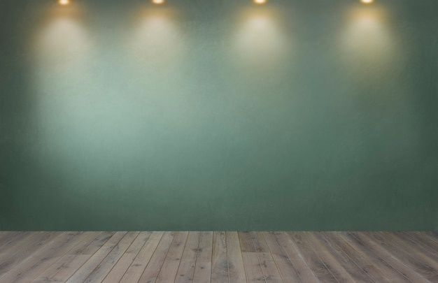 Grüne wand mit einer reihe von scheinwerfern in einem leeren raum Kostenlose Fotos
