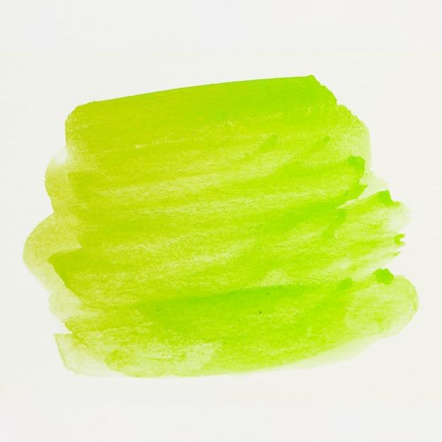 Grüner aquarellfleckstrich auf weißem segeltuch Kostenlose Fotos