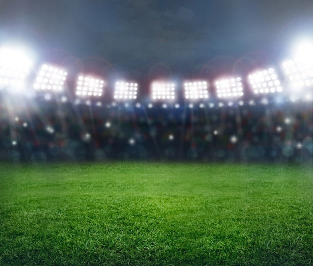 Grüner fußballstadionhintergrund. Premium Fotos