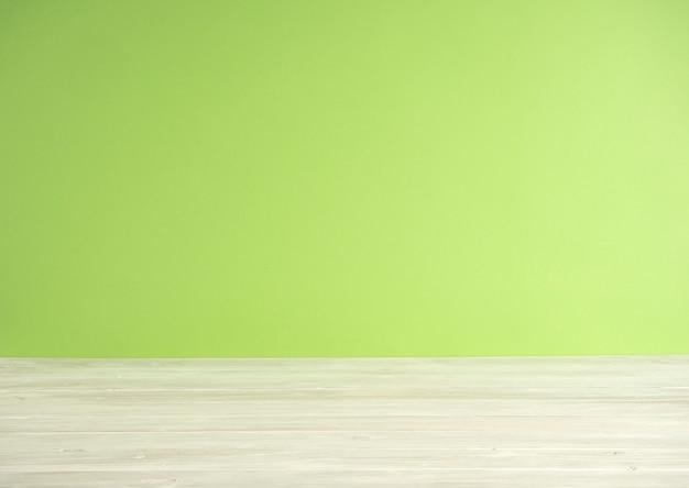 Grüner unschärfehintergrund mit bretterboden Premium Fotos