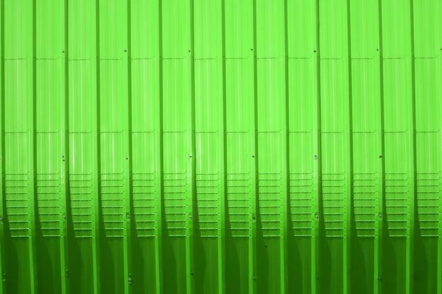 Grünes blechmuster und vertikale linie design Premium Fotos