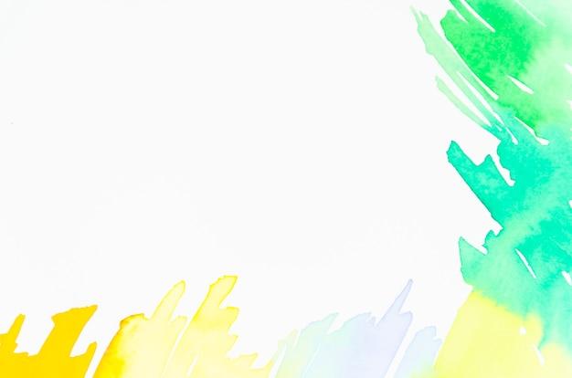 Grünes und gelbes aquarelldesign auf weißem hintergrund Kostenlose Fotos