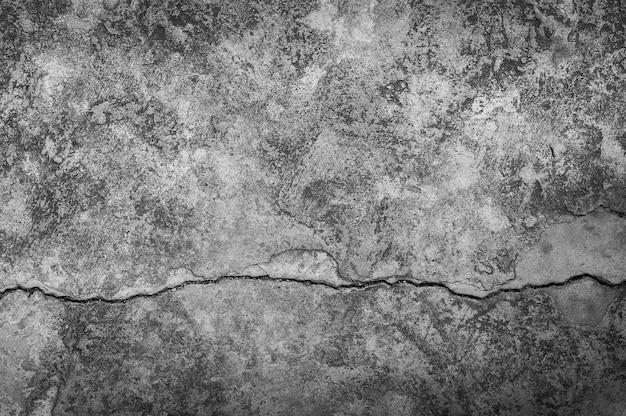 Grungy wand mit großer risszementbodentextur, großer zementriss für dunklen hintergrund Premium Fotos