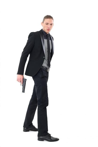 Gut aussehender mann mit pistole Kostenlose Fotos