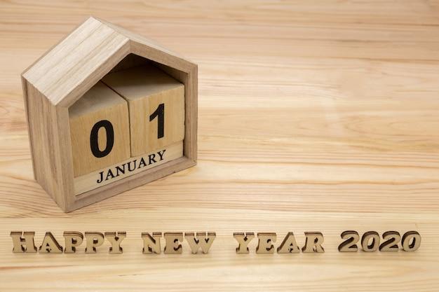 Guten rutsch ins neue jahr 2020 und holzhauskalender Premium Fotos