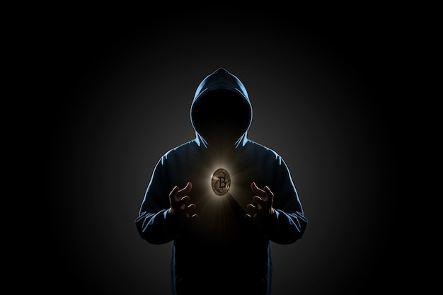Hacker im dunklen hintergrundkonzept Premium Fotos