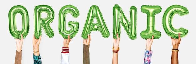 Hände, die organisches ballonwort zeigen Kostenlose Fotos