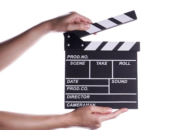 Hände, die scharnierventilbrett- oder -schieferfilmkonzept halten. Premium Fotos