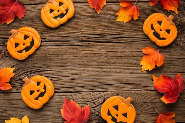 Halloween-parteiaufkleber auf hölzernem hintergrund Kostenlose Fotos