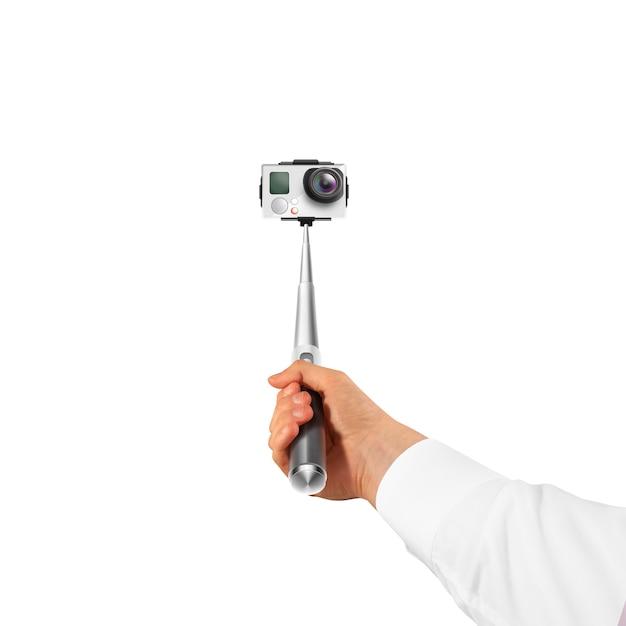 Hand, die aktionskamera lokalisiert hält Premium Fotos