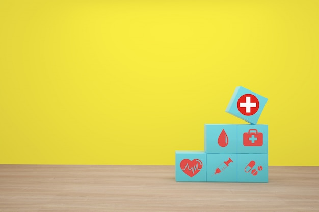 Hand, die den blauen würfelblock stapelt mit dem ikonengesundheitswesen medizinisch vereinbart. Premium Fotos