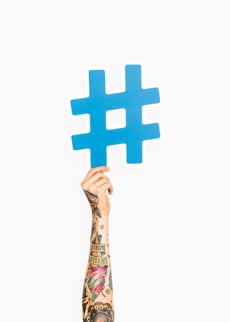 Hand, die hashtag-symbol hält Kostenlose Fotos
