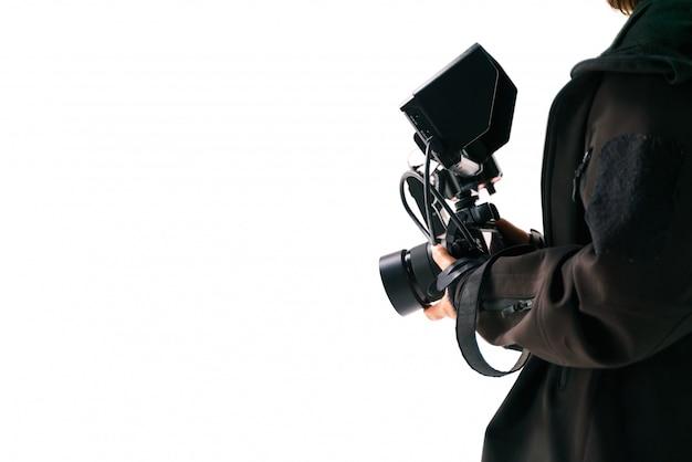 Hand, die kamera mit externem monitor hält Premium Fotos
